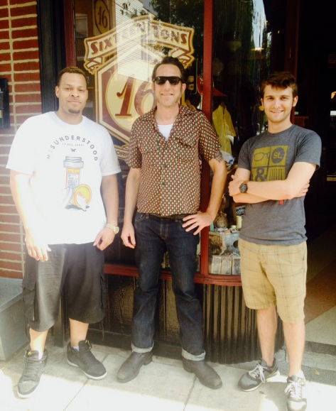 Production crew for the Sixteen Tons shoot outside of owner Daniel Wylie's storefront.